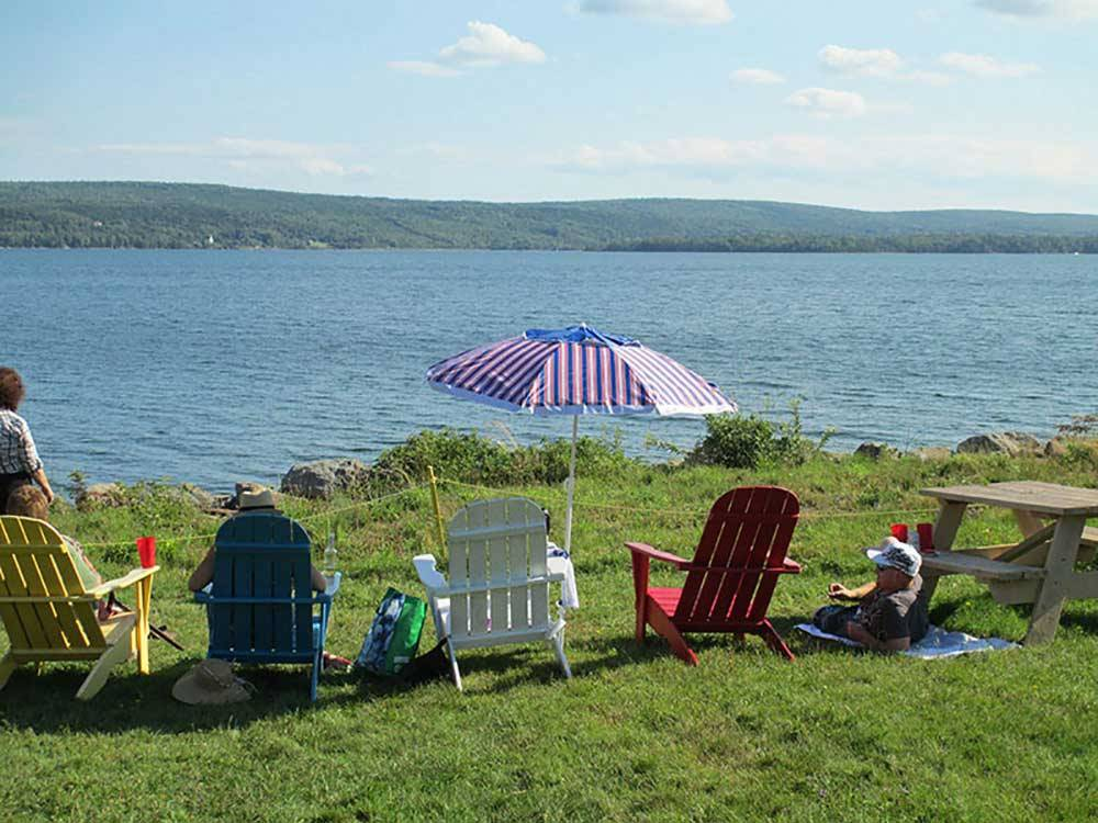 Sitting lakeside in Adirondack chairs at BRAS DOR LAKES CAMPGROUND ON THE CABOT TRAIL