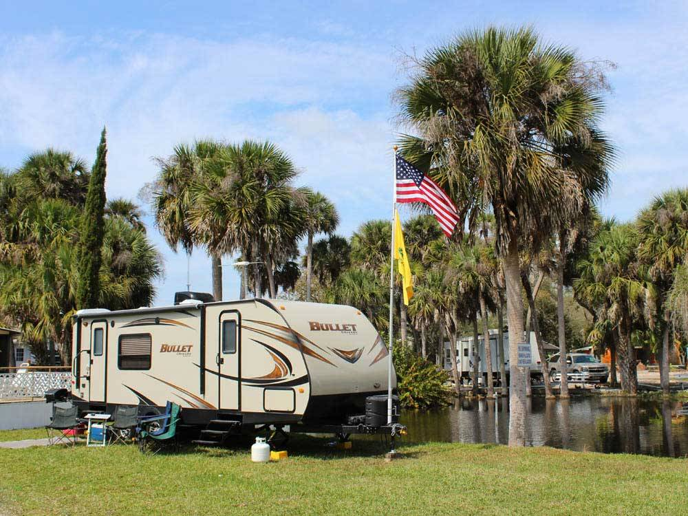 Trailer camping on the water at RAMBLERS REST RV CAMPGROUND