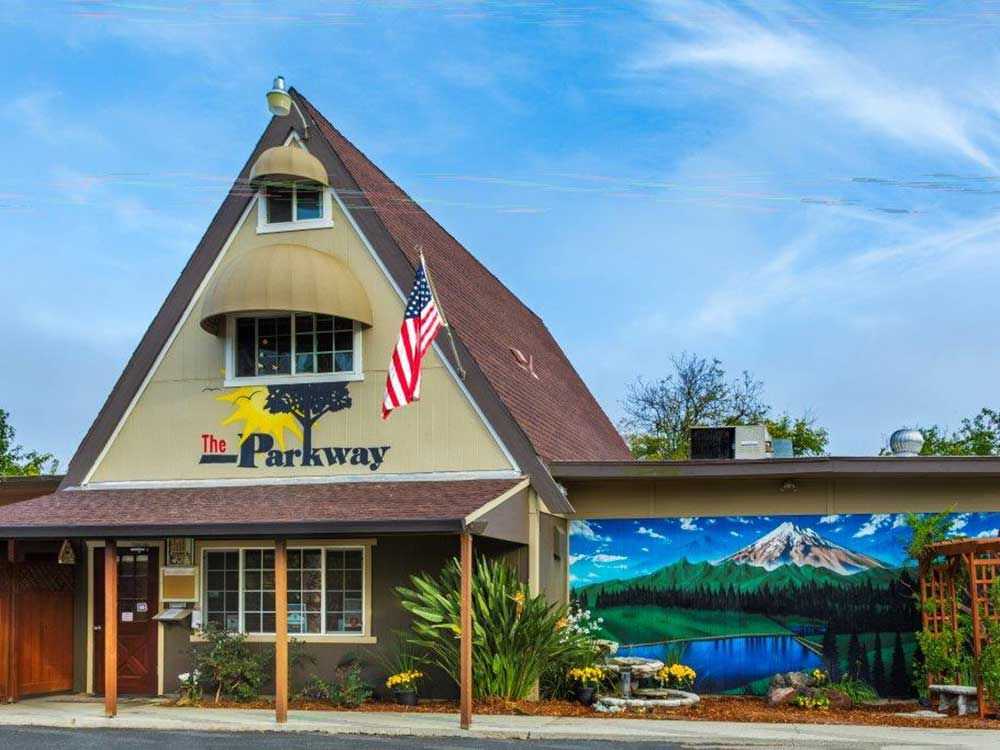 Exterior of A-frame office with mural at THE PARKWAY RV RESORT  CAMPGROUND
