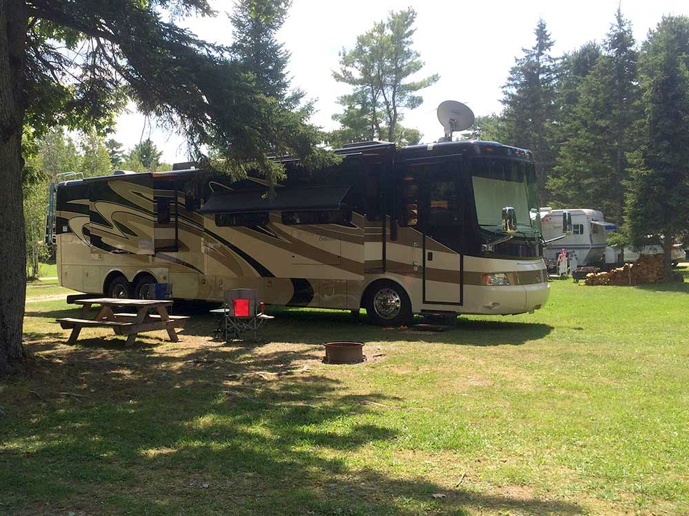 Black brown motorhome camping outside at COLD RIVER CAMPGROUND