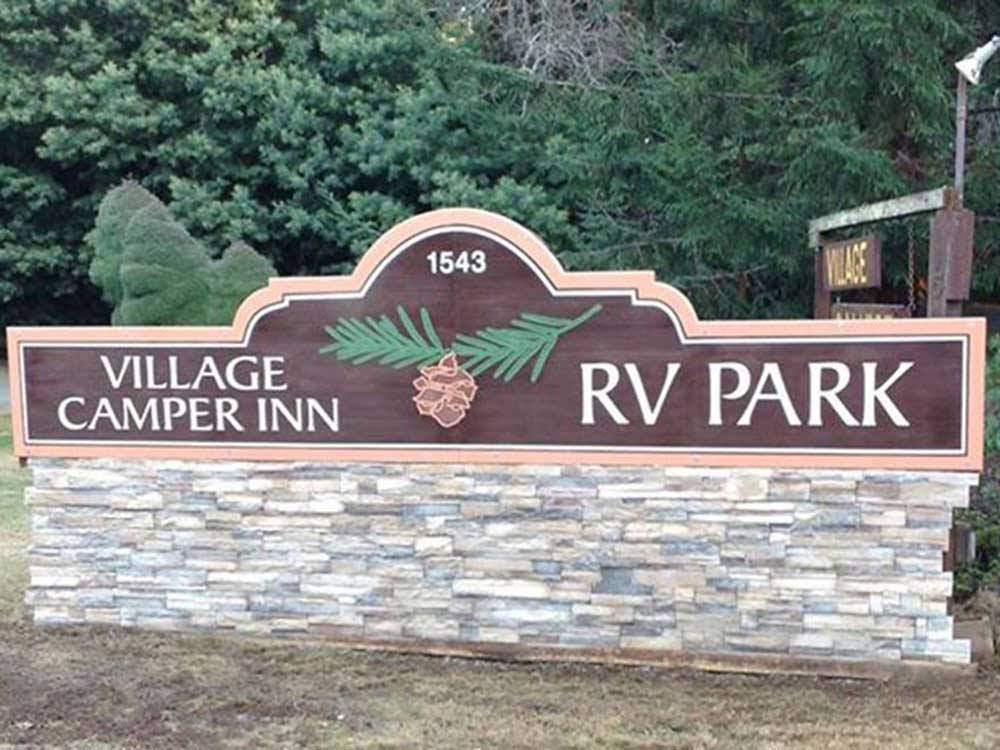 Sign at entrance to RV park at VILLAGE CAMPER INN RV PARK