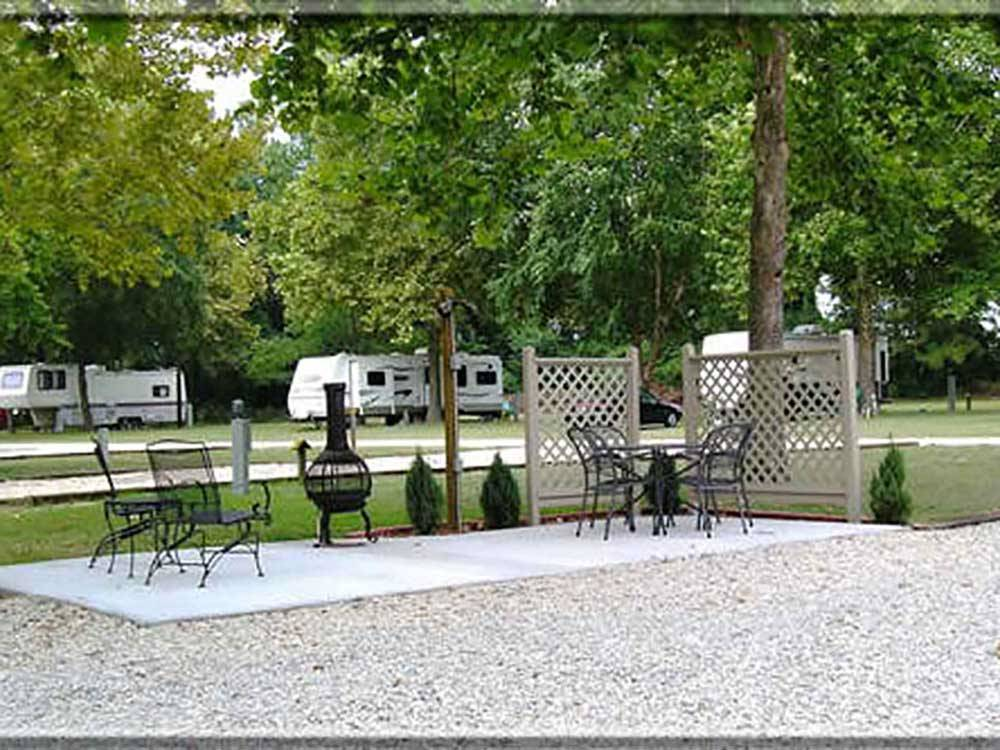 Patio area at FAYETTEVILLE RV RESORT  COTTAGES