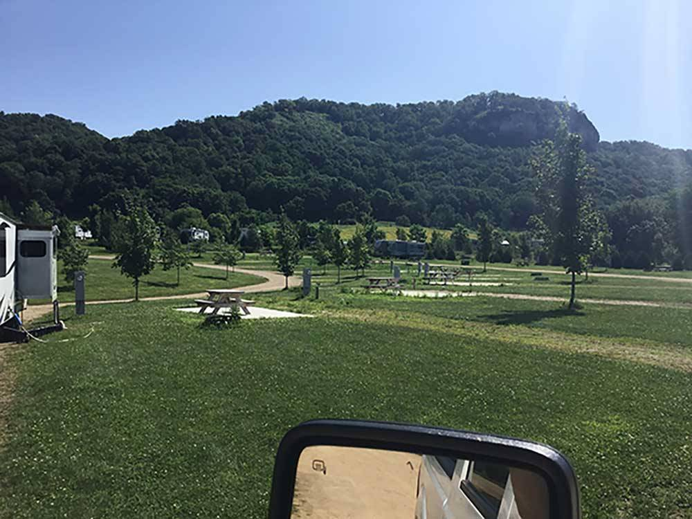 View of the grassy resort and hills at HIAWATHA TRAILER RESORT