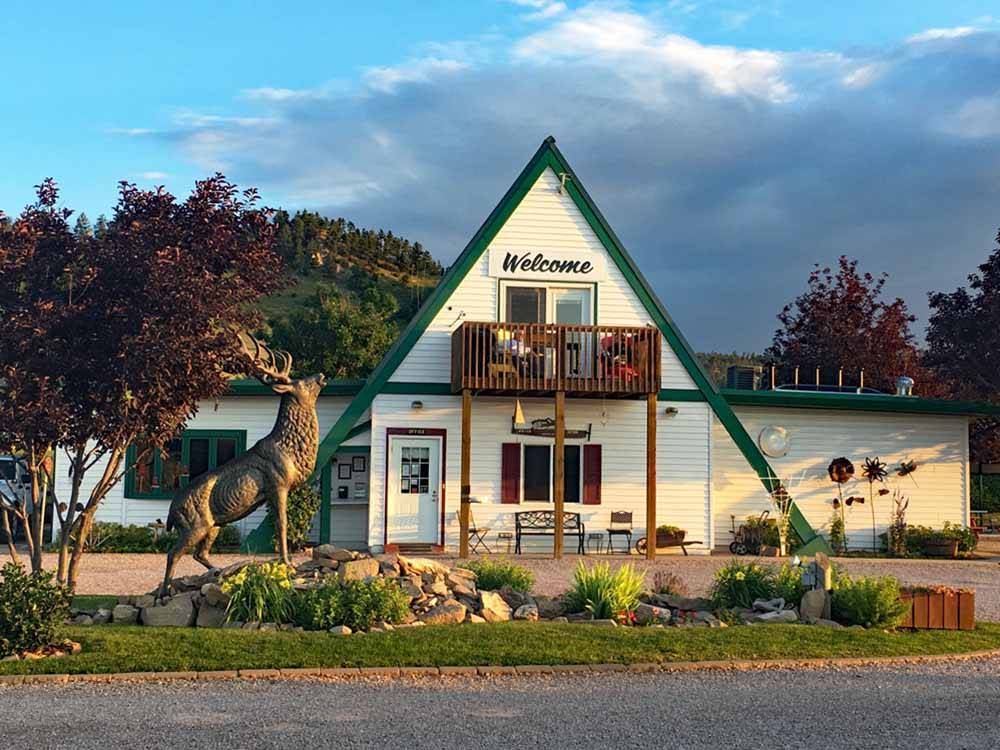 Office building with a moose statue in front at MOUNTAIN VIEW RV PARK  CAMPGROUND