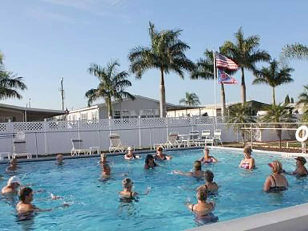 People swimming in the pool at TAMIAMI RV PARK