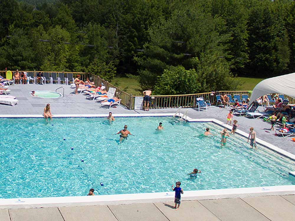 The giant pool area overlooking the woods at SKYWAY CAMPING RESORT