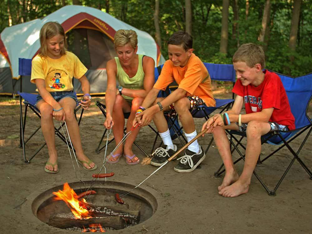 Kids roasting hotdogs at WILDWOOD CAMPGROUND