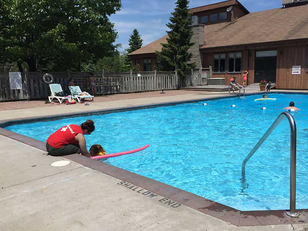 Kids swimming in pool at RIDEAU ACRES CAMPING RESORT