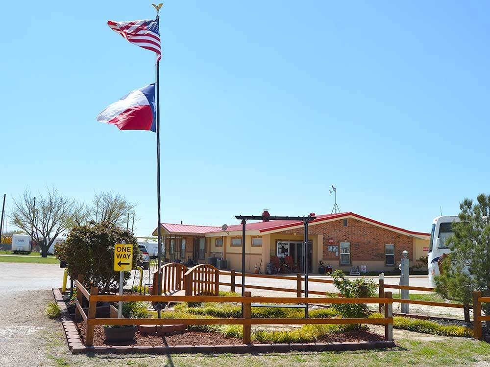 Entrance with office with flags at ABILENE RV PARK