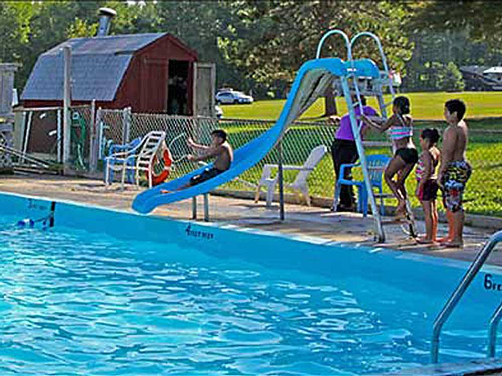 People swimming in the pool at COUNTRY ROADS CAMPGROUND