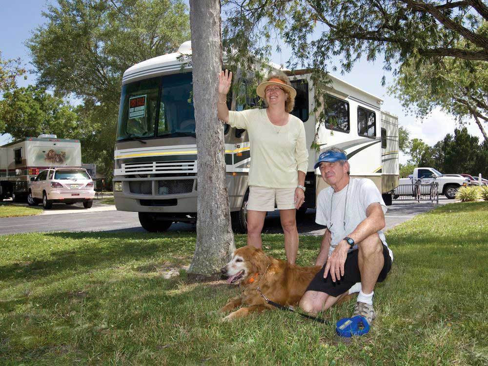Couple with dog at DUNEDIN RV RESORT
