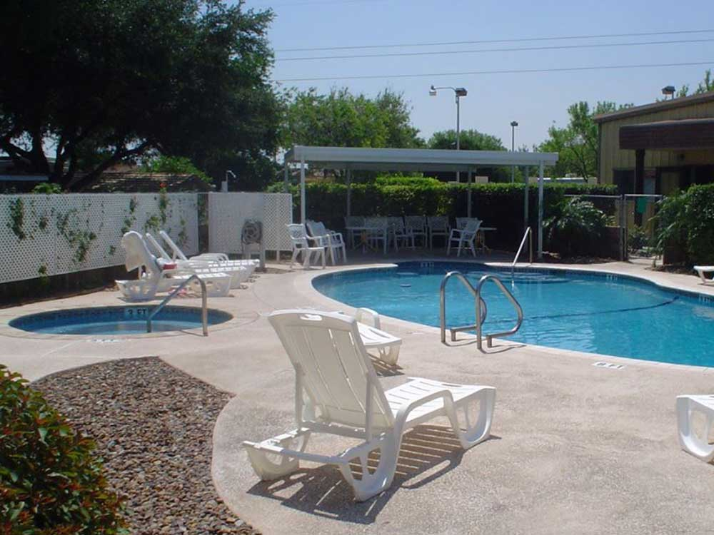 Pool with hot tub at SPLIT RAIL RV PARK