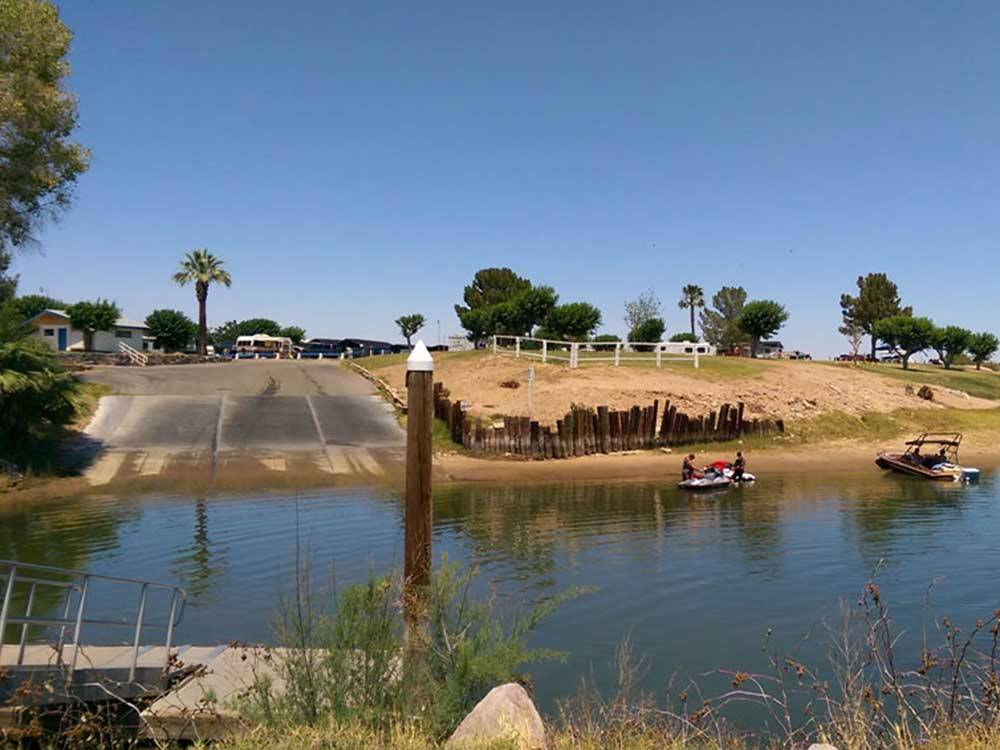 Boat ramp and boats in the water at DESTINY RV RESORTS-MCINTYRE