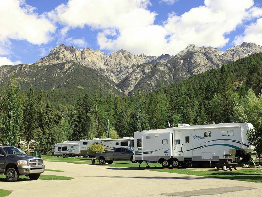 RV sites with mountains in the background at FAIRMONT HOT SPRINGS RESORT