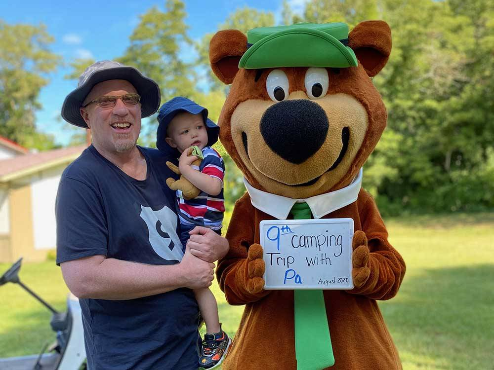 Picnic tables and trailers camping at YOGI BEARS JELLYSTONE PARK CAMP-RESORT
