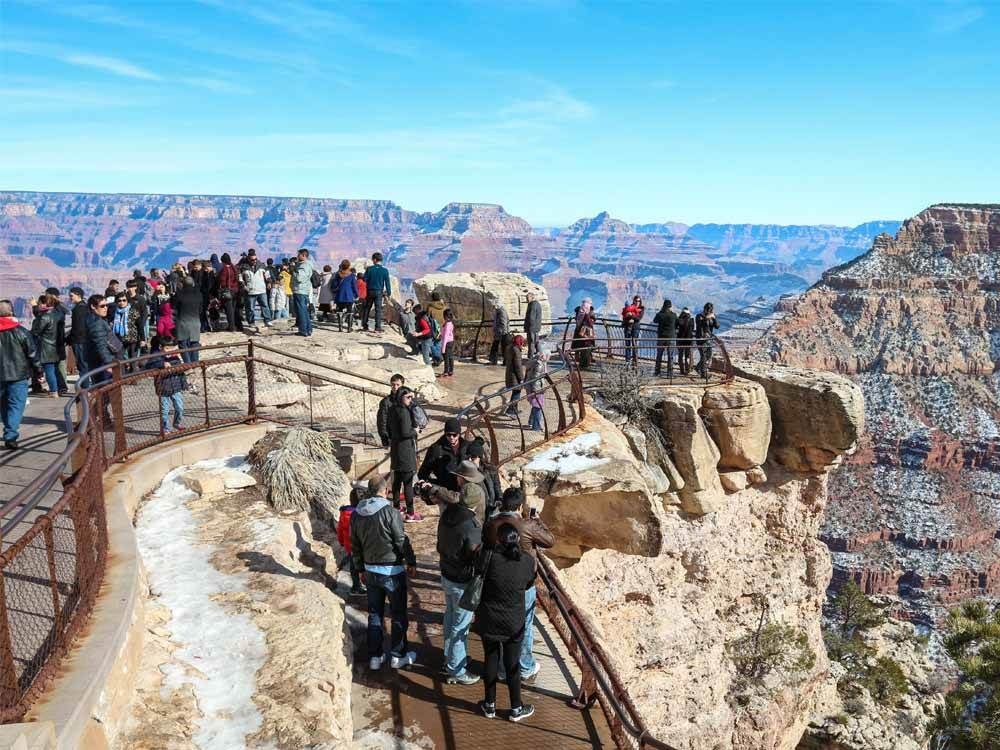 People on the overlook area at the Grand Canyon at GRAND CANYON TRAILER VILLAGE RV PARK