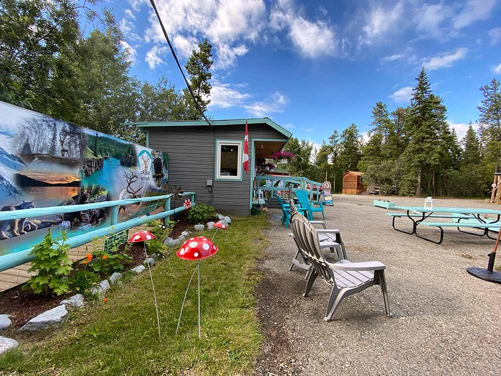 Lodge office with a lot of purple flowers in front at CARIBOU RV PARK