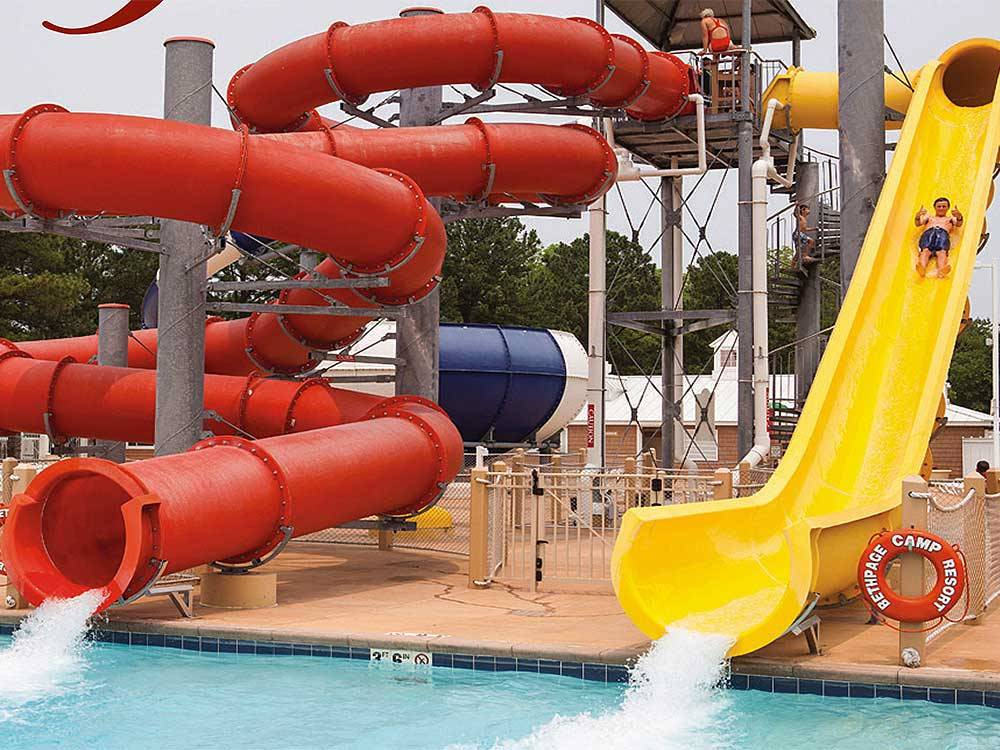 Red and yellow water slides at BETHPAGE CAMP-RESORT