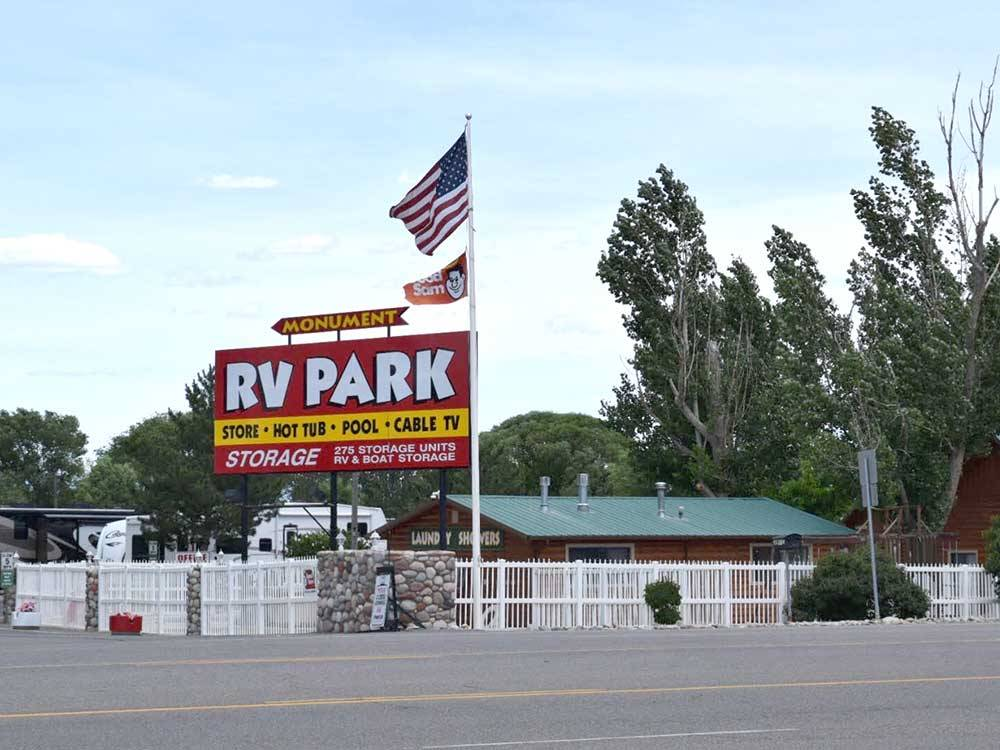 Sign at entrance to RV park at MONUMENT RV RESORT