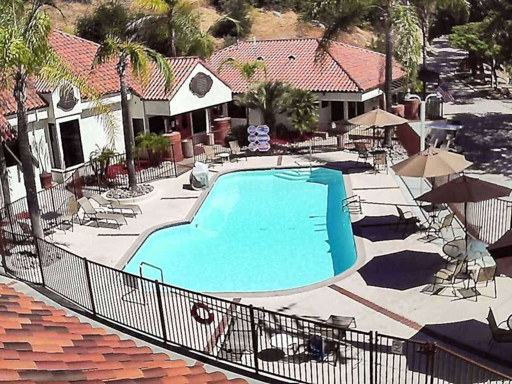 Aerial view of swimming pool and outdoor seating at RANCHO LOS COCHES RV PARK