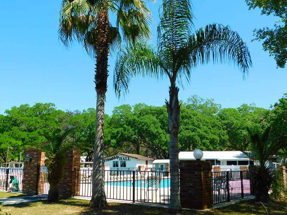 Standing behind the fence looking at the pool at SOUTHERN AIRE RV RESORT
