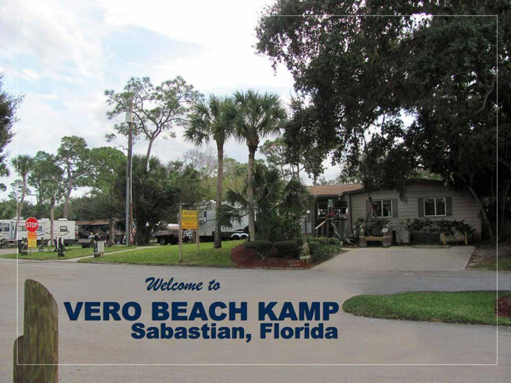 Road leading into lodge office with RVs in background at VERO BEACH KAMP