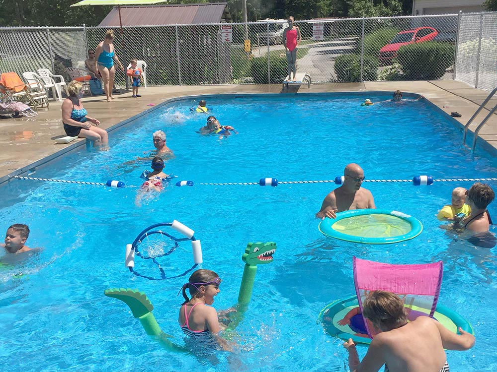 People swimming in the pool at GRANDPAS FARM