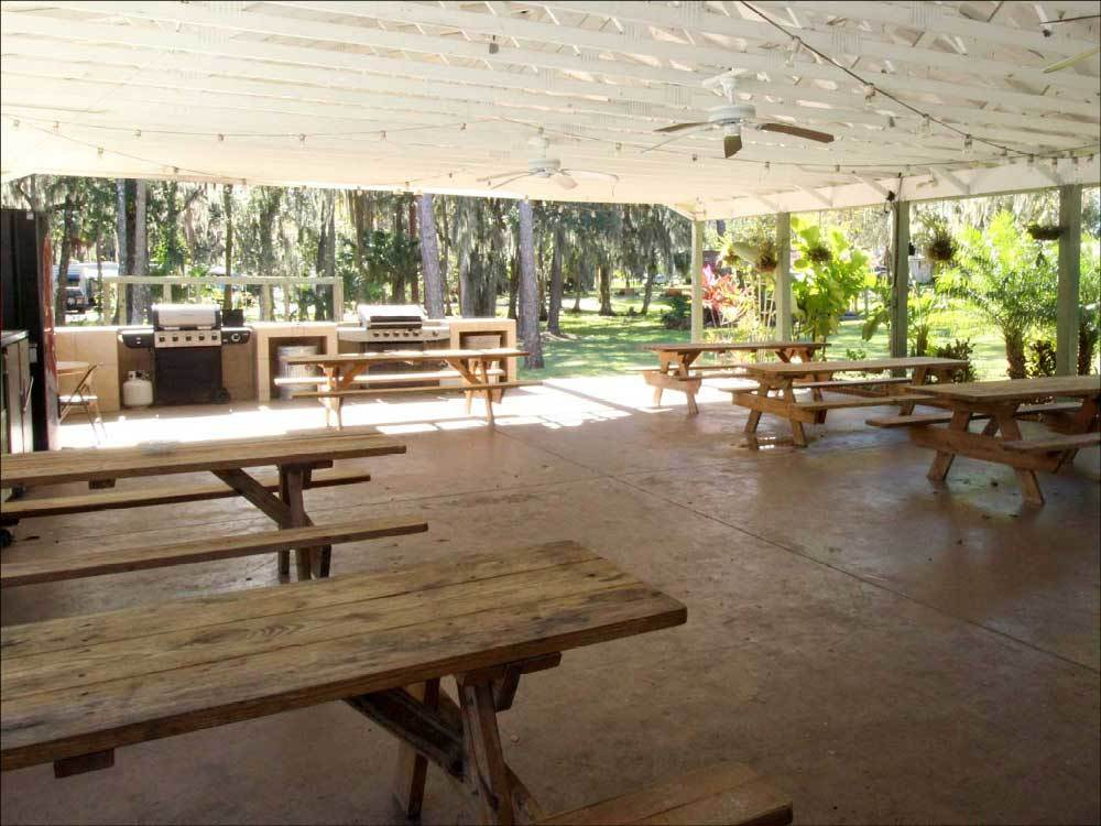 Patio area with picnic tables at HIDDEN RIVER RESORT
