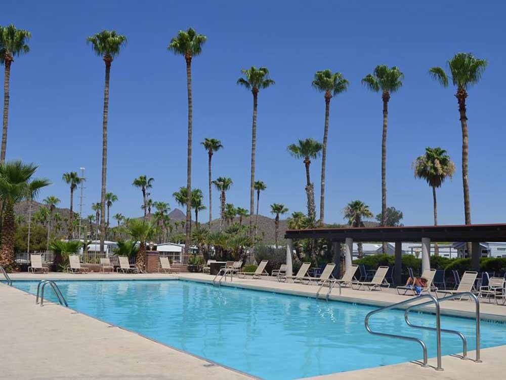 Swimming pool with outdoor seating at RINCON COUNTRY WEST RV RESORT