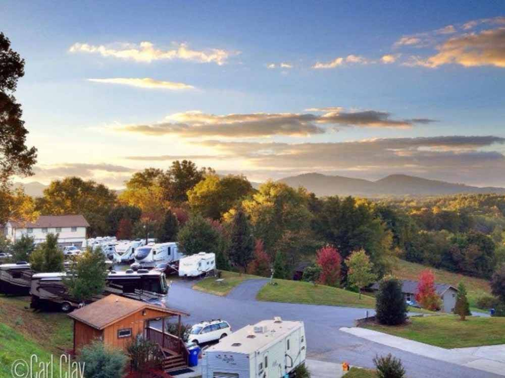 View of park and hills at sunset at ASHEVILLE BEAR CREEK RV PARK