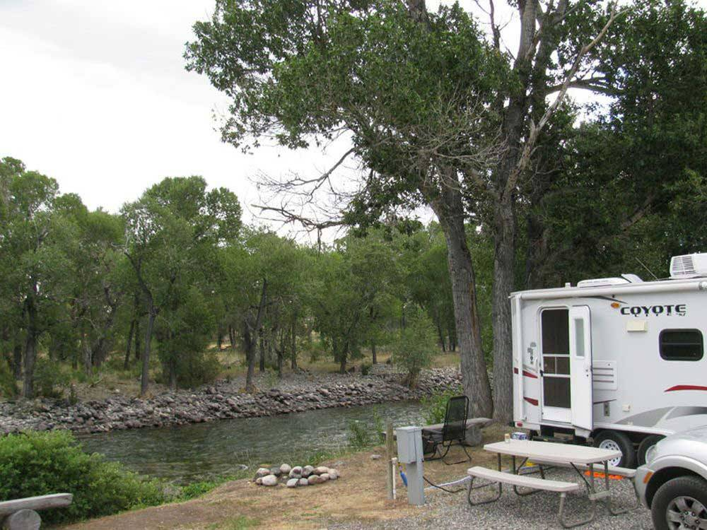 Trailer camping on the water at SPRING CREEK CAMPGROUND  TROUT RANCH