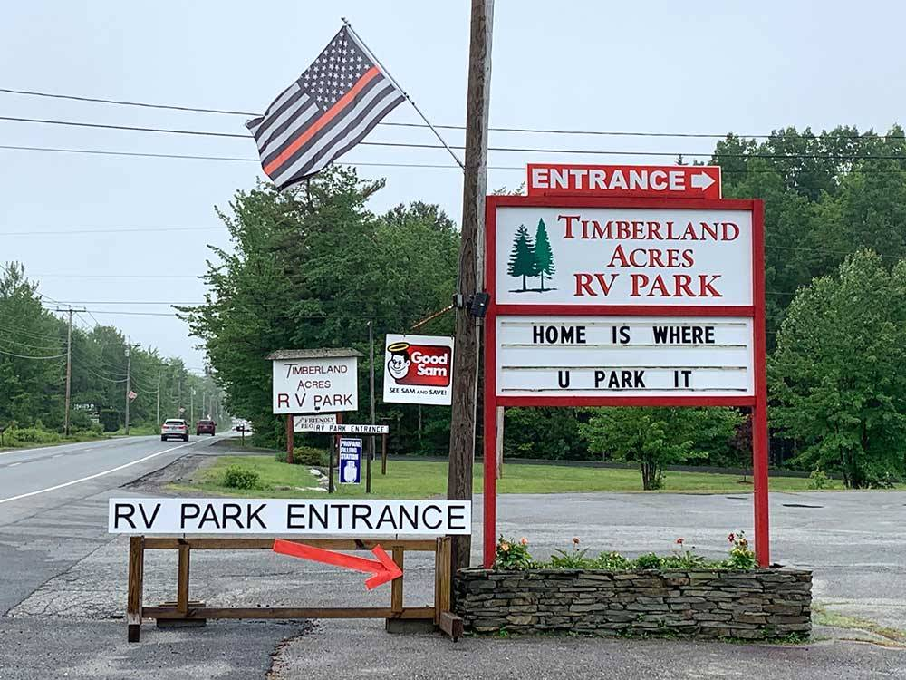 Sign and flag to RV Park entrance at TIMBERLAND ACRES RV PARK