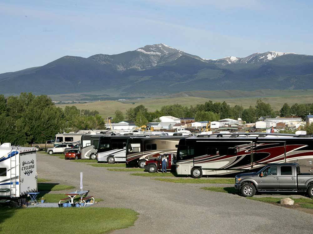 Snowcapped mountains and RVs camping at INDIAN CREEK RV PARK  CAMPGROUND