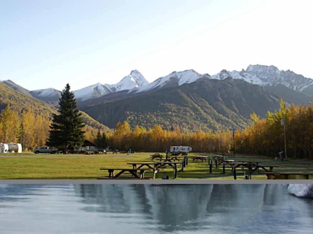 RV sites and snow capped mountains at MOUNTAIN VIEW RV PARK