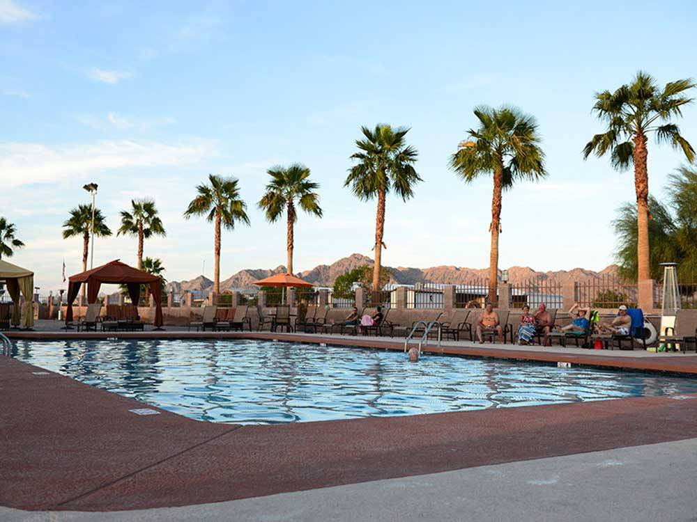 Swimming pool with outdoor seating at FORTUNA DE ORO RV RESORT