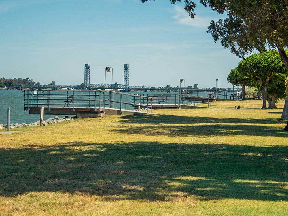 A view of the docks and grassy area at DUCK ISLAND RV PARK  FISHING RESORT