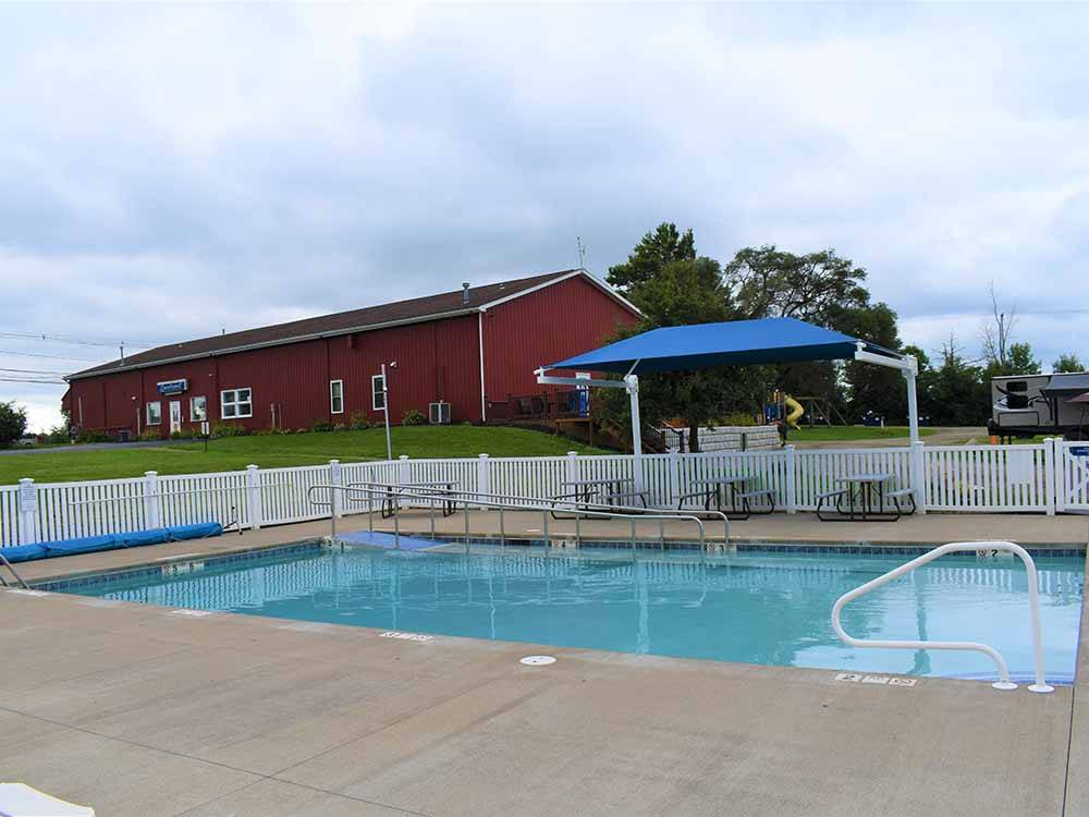 The swimming pool area at PRESQUE ISLE PASSAGE RV PARK  CABIN RENTALS