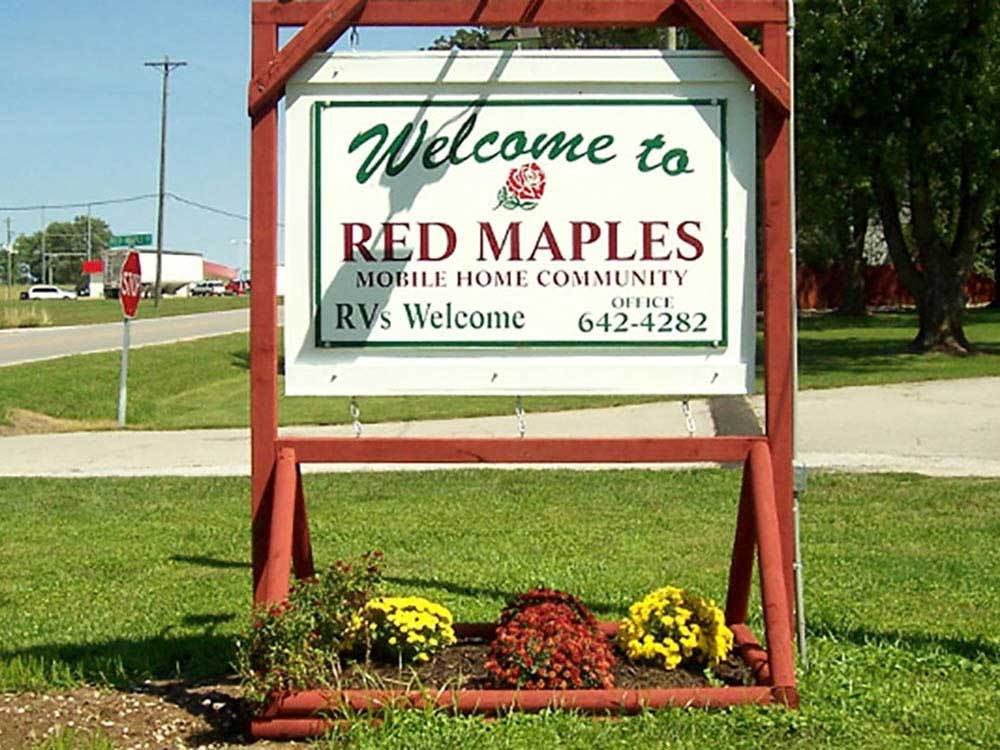 Sign at entrance to RV park at RED MAPLES MH AND RV COMMUNITY