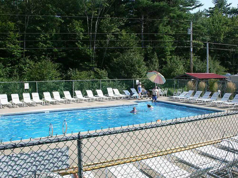 Swimming pool with outdoor seating at TWIN TAMARACK FAMILY CAMPING  RV RESORT