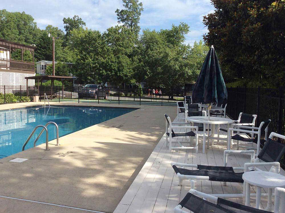 Swimming pool with outdoor seating at LAKEWOOD RV RESORT