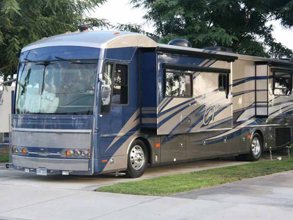 Silver and blue motorhome RV camping at ANAHEIM RV PARK