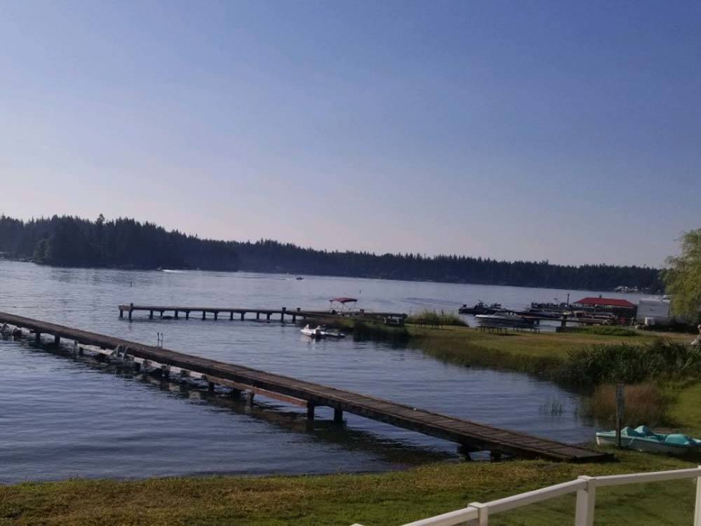 Aerial view of sites and office with evergreen trees in background at CEDAR GROVE SHORES RV PARK