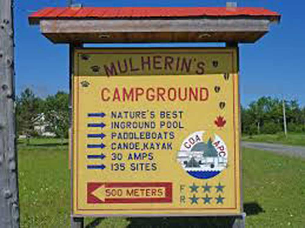 Sign at entrance to RV park at MULHERINS CAMPGROUND