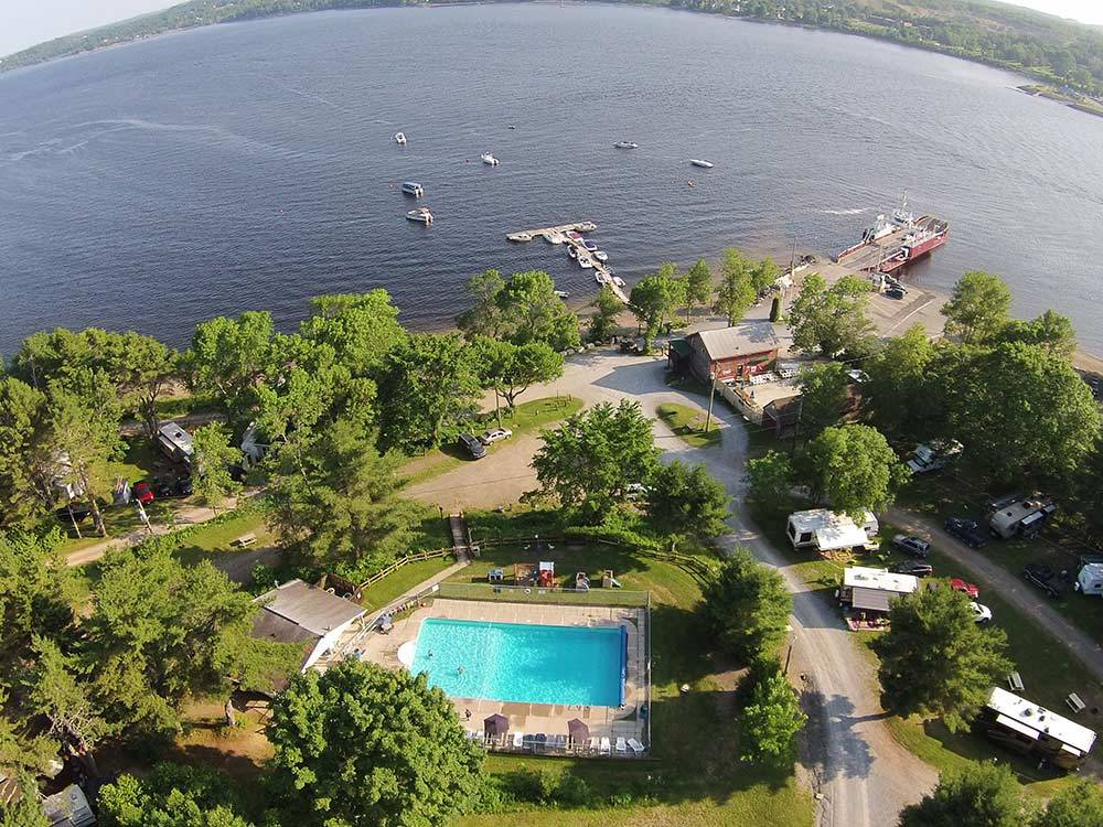 Aerial view of beautiful pool woods and lake with boats at HARDINGS POINT CAMPGROUND