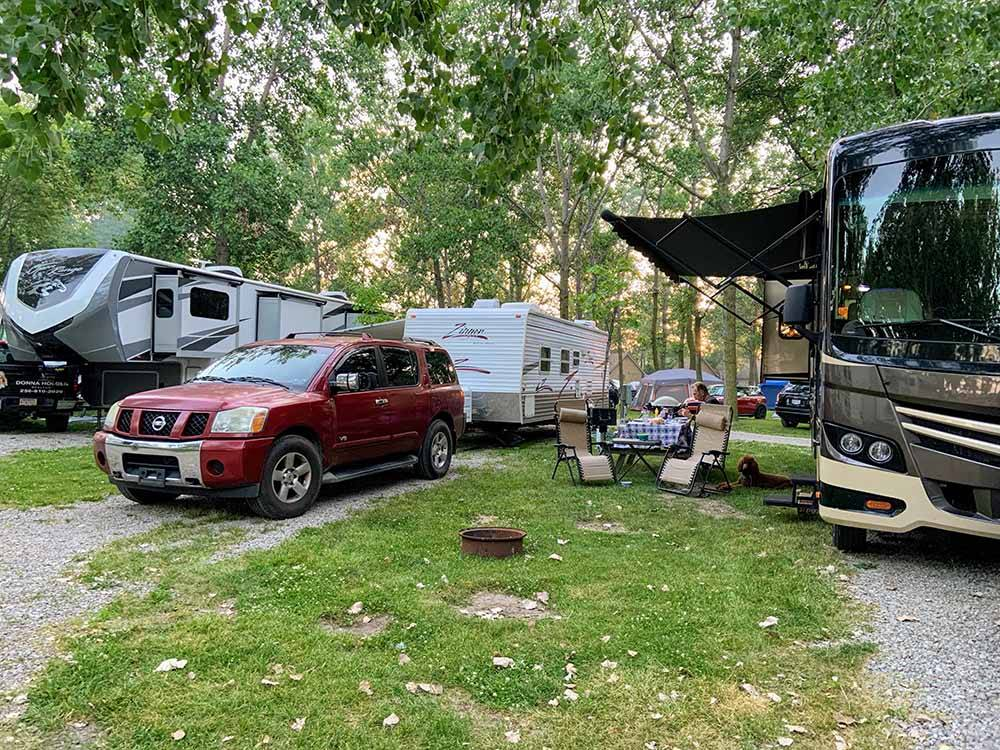 A group or RVs in gravel sites at CAMP SANDUSKY