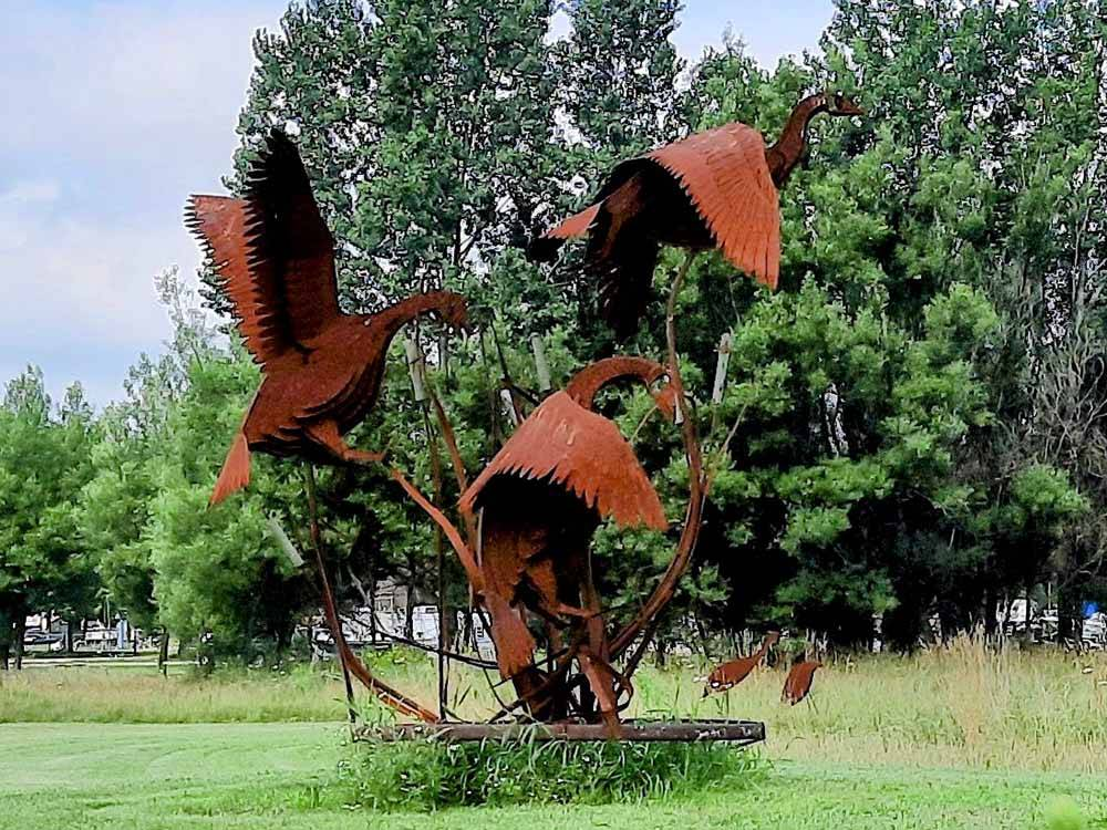 Boat hitched to a silver Chevy truck at KEWAUNEE RV  CAMPGROUND