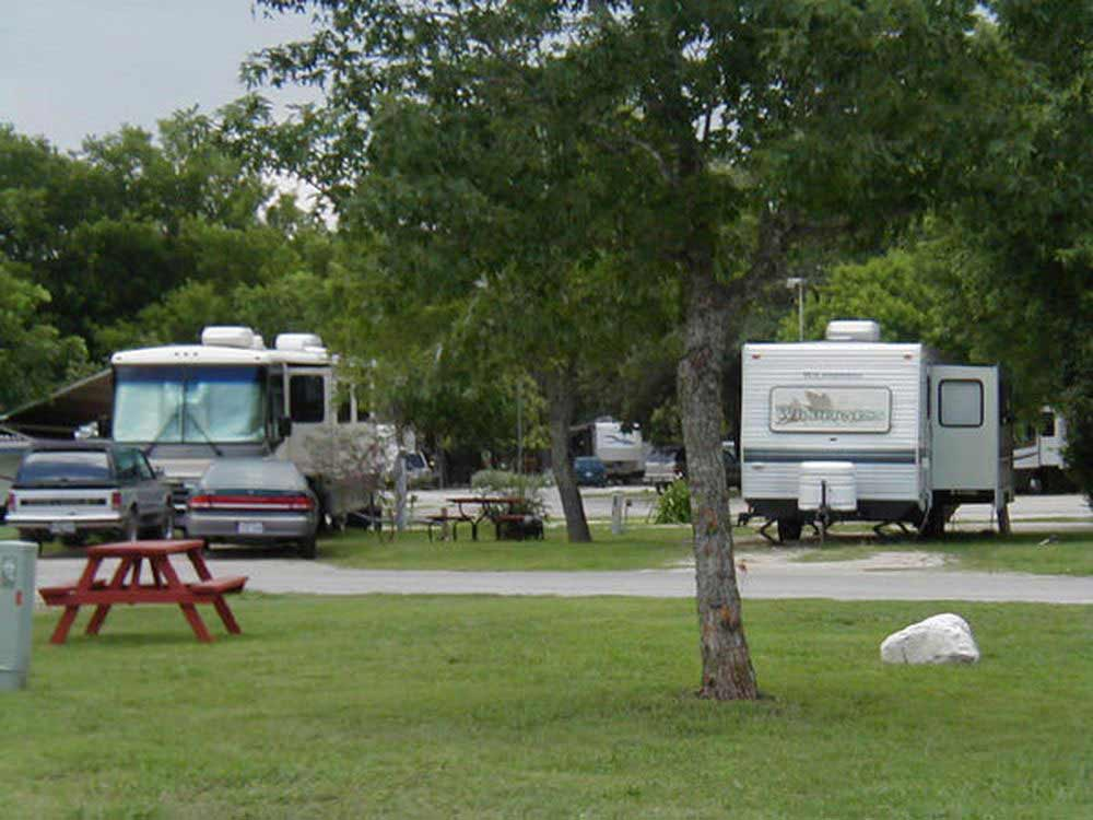 Picnic table and trailers camping at ALAMO FIESTA RV RESORT