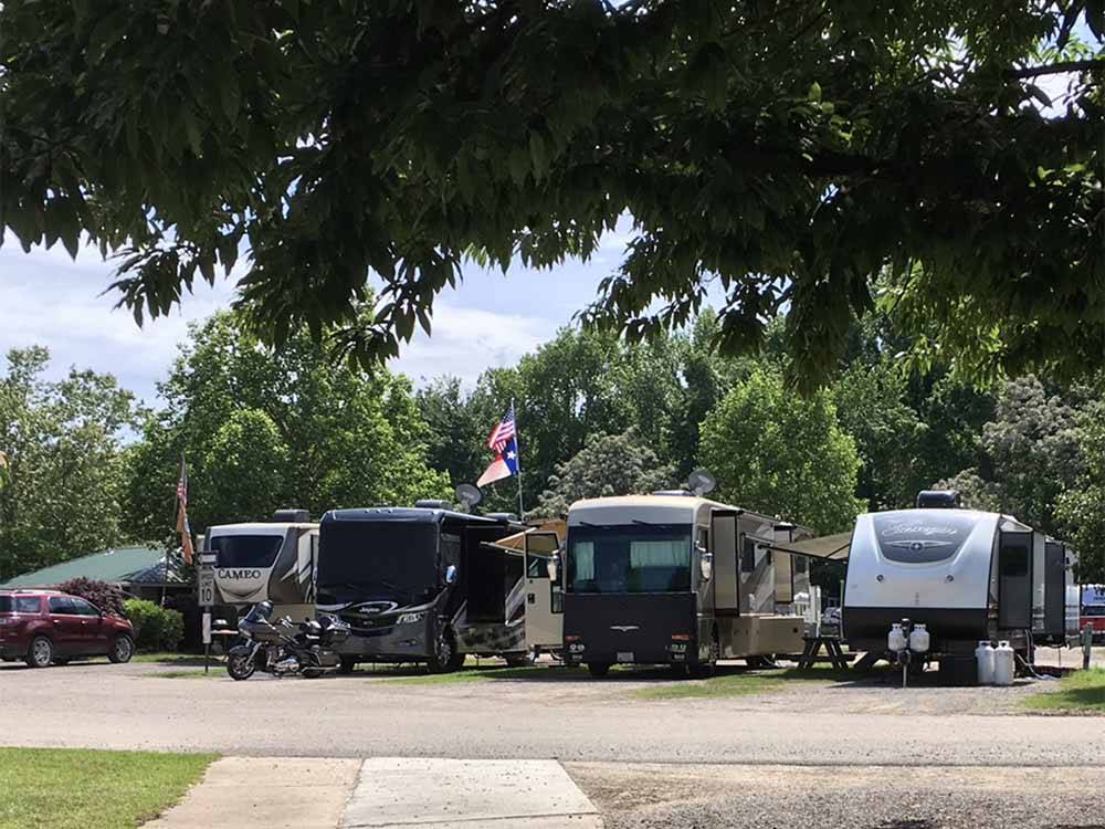Trailers camping at OUTDOOR LIVING CENTER RV PARK