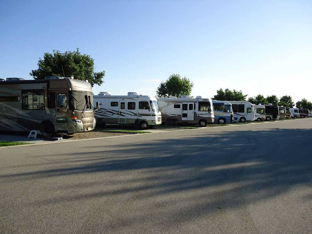 RVs parked in a row at HI VALLEY RV PARK