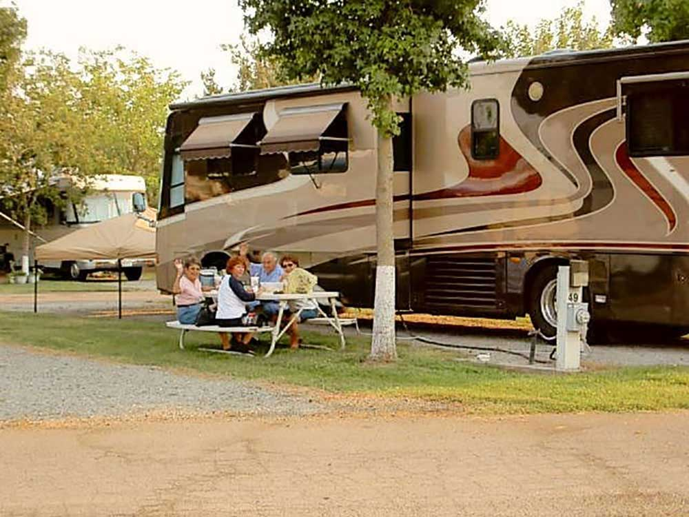 Family camping in RV at HERITAGE RV PARK